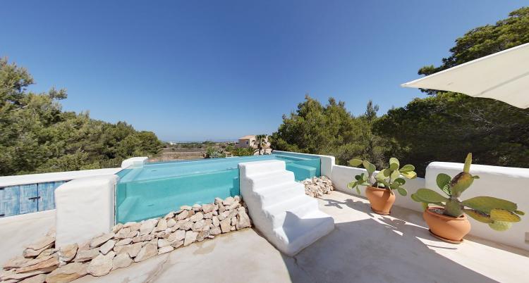 Bella villa a Formentera con piscina in vetro e vista sul mare ed Es Vedrá